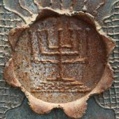 Close-up Of Antique Decorative Menorah On A Leaf Of Metal.