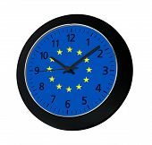 Black Clock With Flag Of Europe On Wall