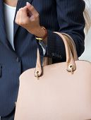 Businesswoman Holding Beige Handbag