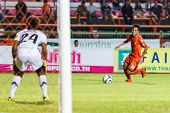 Sisaket Thailand-may 21: Tatree Siha Of Sisaket Fc. (orange) In Action During Thaicom Fa Cup Between
