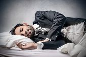 foto of fatigue  - sleeping businessman - JPG