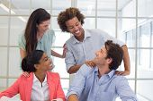 stock photo of praises  - Workers congratulating and praising one another in the office - JPG