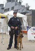 NYPD counter terrorism officer with Belgian shepherd providing security during Fleet Week 2014