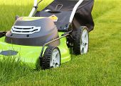 foto of clippers  - Man cutting the grass with lawn mower - JPG