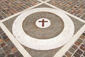 stock photo of porphyry  - Geometric floor with blocks of porphyry white marble and Christian cross of brown marble - JPG