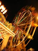 stock photo of funfair  - colourful blur of night - JPG