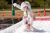 Woman Covered In Foam At Crazy Obstacle Course Race