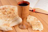 stock photo of communion-cup  - Cup of wine and bread on table close - JPG