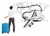 Young Businessman Drawing Airplane And Airline Path On The Map