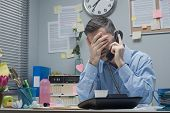 Stressed Employee On The Phone