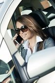 Attractive Woman Driving And Talking On The Phone