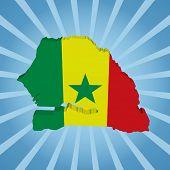 Senegal map flag on blue sunburst illustration