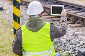 Engineer filmed the railway with tablet PC