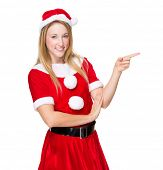 Woman with Xmas dress and finger point aside