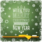 Wish you merry christmas and a happy new year message, written on the school chalkboard.