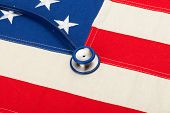 Stethoscope Over Us Flag - Heath Care Concept