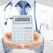 Doctor Holdling In His Hand Calculator - Studio Shoot