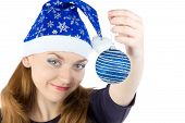 Photo of woman with christmas balls in hat