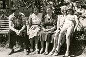 LODZ, POLAND, CIRCA SIXTIES: Vintage photo of women and children sitting on bench