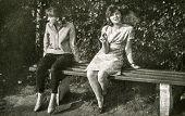 LODZ, POLAND, CIRCA SIXTIES: Vintage photo of women sitting on bench