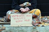stock photo of scourge  - Homeless man holds out hand - JPG