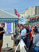 Tourists Eat Jellied Eel On Beach In Brighton.