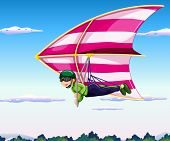 Hang glider flying in sky