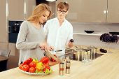 Happy young couple cooking a dinner on a kitchen. Healthy food. Happy family.