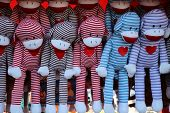 picture of sock-monkey  - A lot of Colorful striped Sock monkeys - JPG