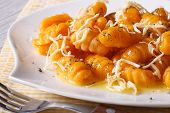 Pumpkin Gnocchi With Cheese And Sauce Close Up. Horizontal