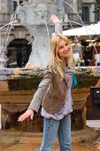 Attractive Girl Near A Fountain Of Madonna On Piazza Delle Erbe In Verona, Italy