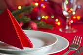 Christmas table with cutlery and tableware in red