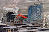 Workers Install A Theatrical Stage For The Annual Festival Of Opera At The Arena Verona. Italy, Vero