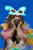stock photo of gargoyles  - Easter Gargoyle with Plastic boa and bunny sun glasses