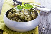 stock photo of stew  - Stewed potato and broccoli with shaved parmesan - JPG
