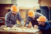 stock photo of wood craft  - Team working on project in industrial wood factory - JPG