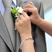 image of boutonniere  - Wedding boutonniere placed on jacket of groom - JPG