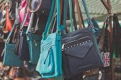 image of stall  - Colorful handbags hanging in a stall at a market - JPG
