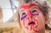 stock photo of scary face  - young kid  - JPG