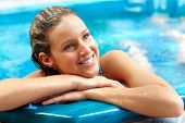 stock photo of hot-tub  - Young woman relaxing in hot tub - JPG