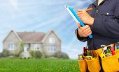 image of handyman  - Builder handyman with construction tools - JPG