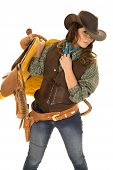 stock photo of cowgirls  - A cowgirl holding on to her saddle on her shoulder - JPG