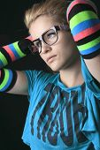 picture of leg warmer  - A Portrait of young woman wearing striped multicolored arm warmers isolated on black - JPG