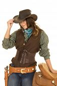 picture of cowgirls  - a cowgirl with her hand on the saddle and her other hand touching her hat - JPG