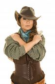 foto of pistols  - a cowgirl with her arms wrapped around herself with her pistol on her shoulder - JPG