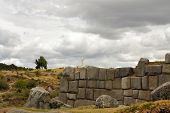 picture of conquistadors  - Jesus statue behind ancient Inca fortress Saksaywaman is a military fortification used against the Spanish conquistadores near Cusco in Sacred Valley - JPG