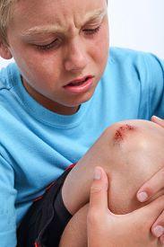 pic of scrape  - Boy with scraped knee - JPG