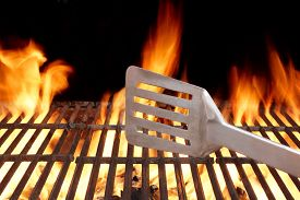 picture of shoulder-blade  - BBQ Grill And Spatula. Flame Of Fire In The Background. ** Note: Shallow depth of field - JPG