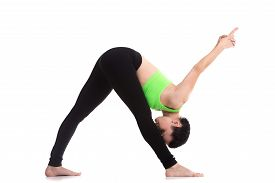 stock photo of mudra  - Slim sporty girl on white background in Intense Side Stretch Pose Parsvottanasana hands behind the back in Vajra Mudra gesture of knowledge exercise for shoulders and legs stretching - JPG