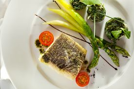 stock photo of halibut  - Halibut Fillet with Asparagus and Spinach - JPG